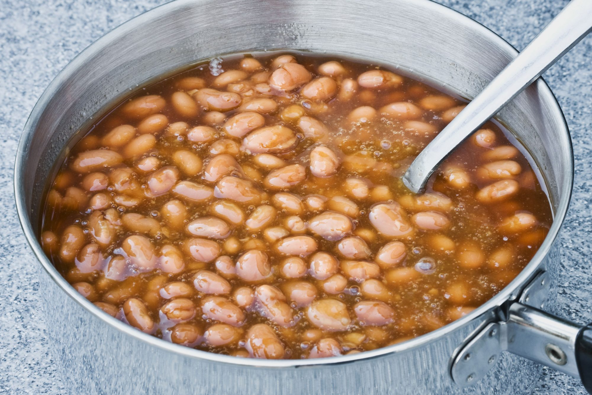 Pinto beans simmering in sauce pan