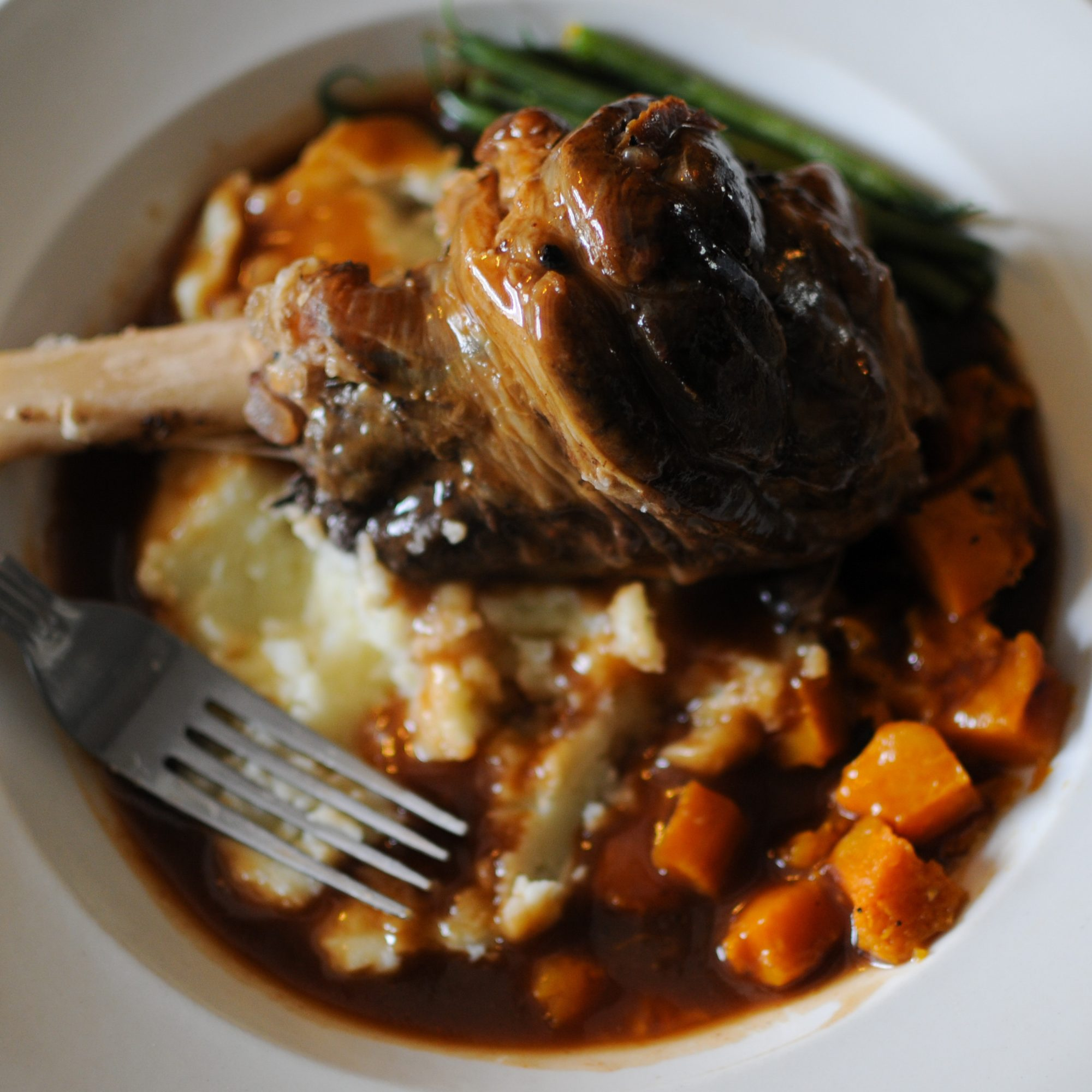 Lamb shank with mash potatoes and carrots