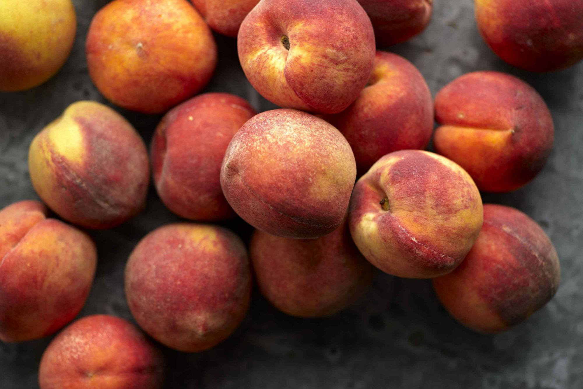 Peaches with slate background