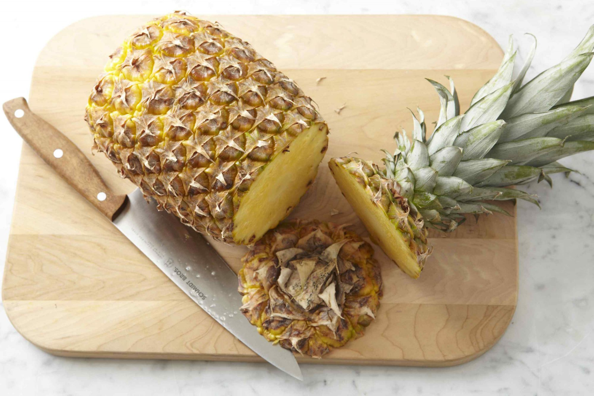 Pineapple on cutting board with knife