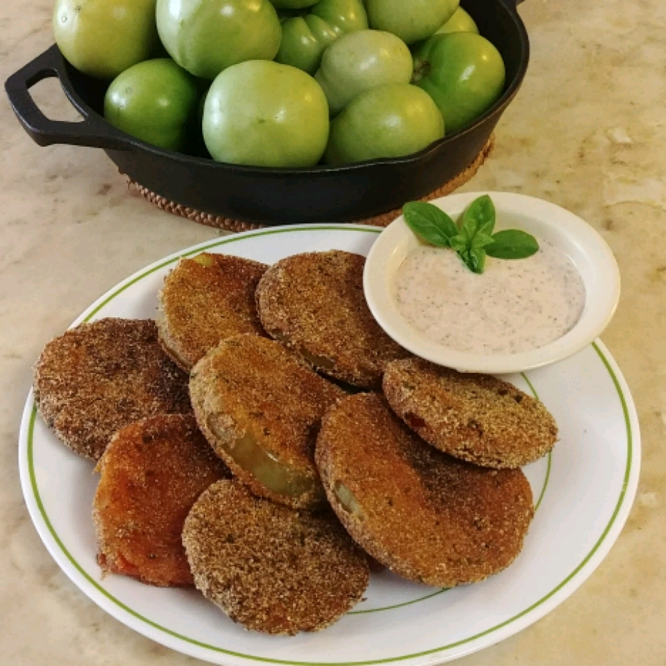 Perfect Fried Green Tomatoes on a white plate with a side of dipping sauce