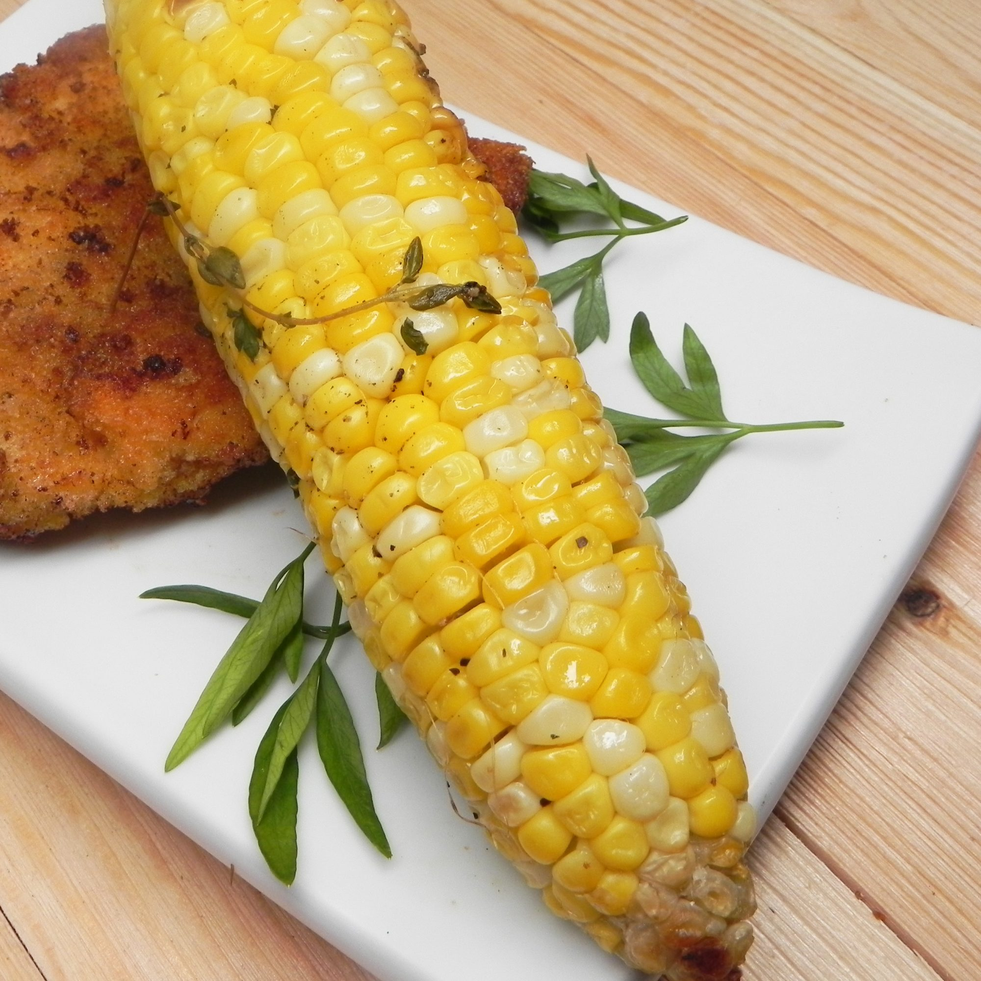 The grill isn't just for meaty mains. It enhances the flavor of plants, too. Case in point: corn on the cob.