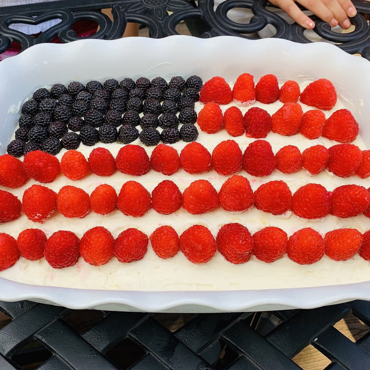This easy Memorial Day dessert won't heat up your kitchen when you make it, and it can feed a crowd. You can use strawberries or raspberries to create the red stripes, if you wish. Tip: To make sure your flag is picture perfect (and the berry juices don't stain the frosting), slice and pack the fruit in separate containers, then top the cake after you get to your picnic perfect spot.