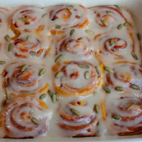 """Make amazing pumpkin cinnamon rolls from scratch with sinfully delicious cinnamon sugar filling and a cream-cheese glaze. """"The addition of pumpkin puree made these the best cinnamon rolls I've ever tasted,"""" says Chef John."""