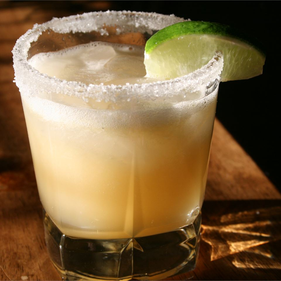 Beer Margarita in a glass with salt rim and lime garnish