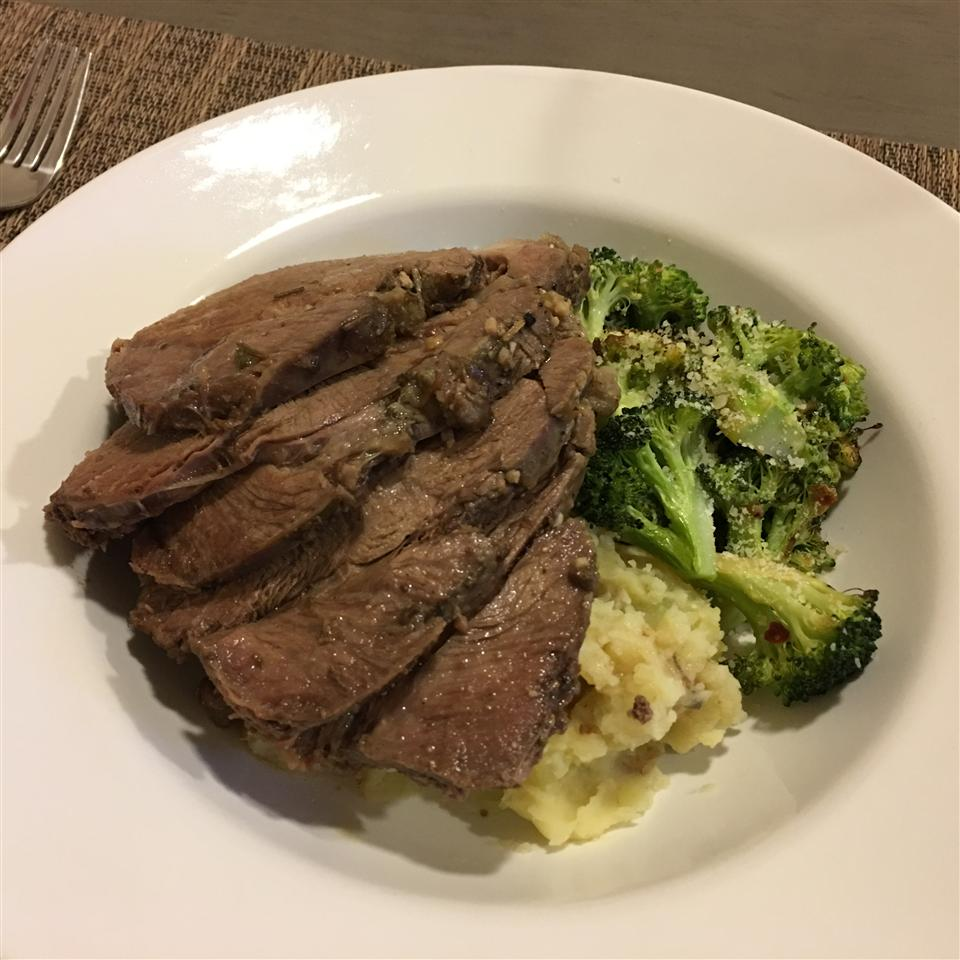 """""""Fall-of-the-bone, flavorful lamb that is easy to throw in the slow cooker in the morning and have a delicious meal ready by dinner time,"""" says recipe creator Kristin88."""