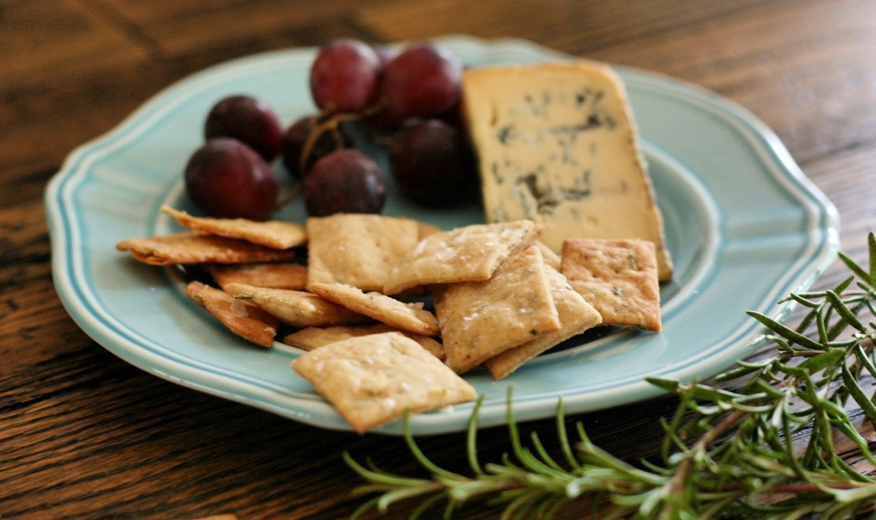 sourdough rosemary crackers with cheese and grapes