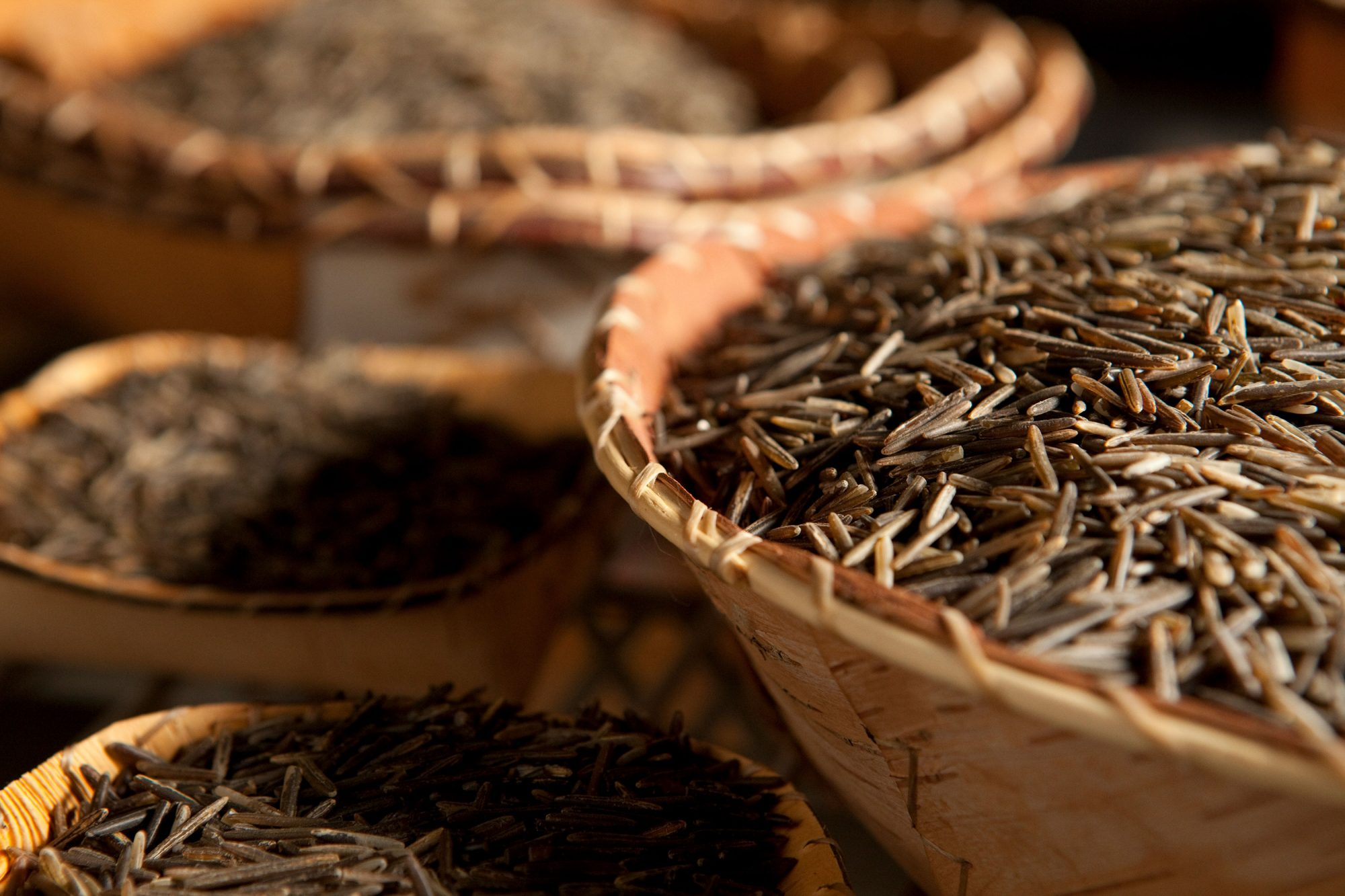 Uncooked wild rice in woven basket