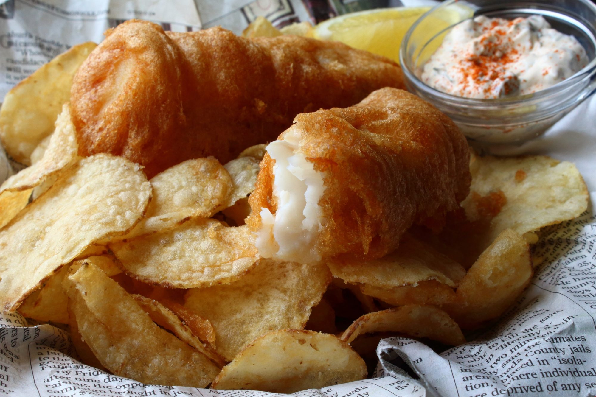 Fried fish and potato chips with aioli