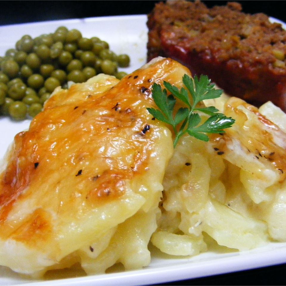Rich and Creamy Potatoes Au Gratin on a white plate