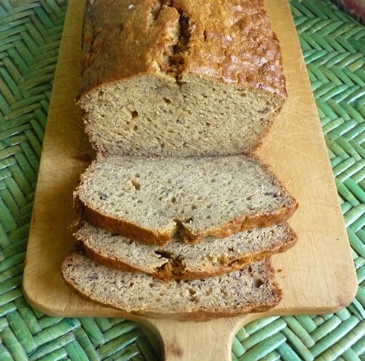 banana bread sliced on a wooden board