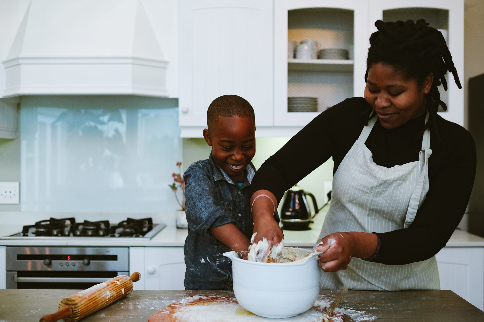 Mother and son mix to make dough