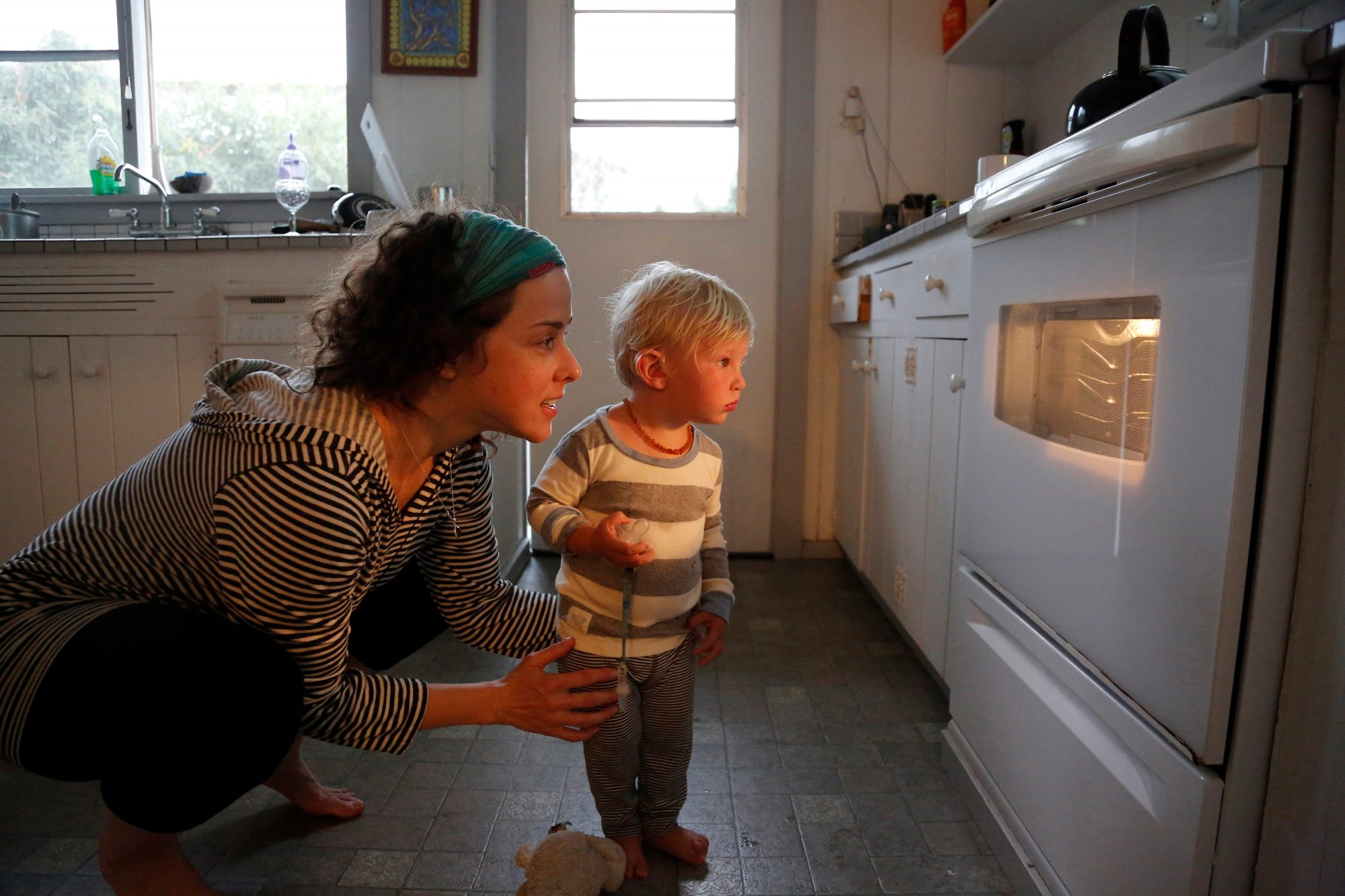 Mother and son looking in oven window