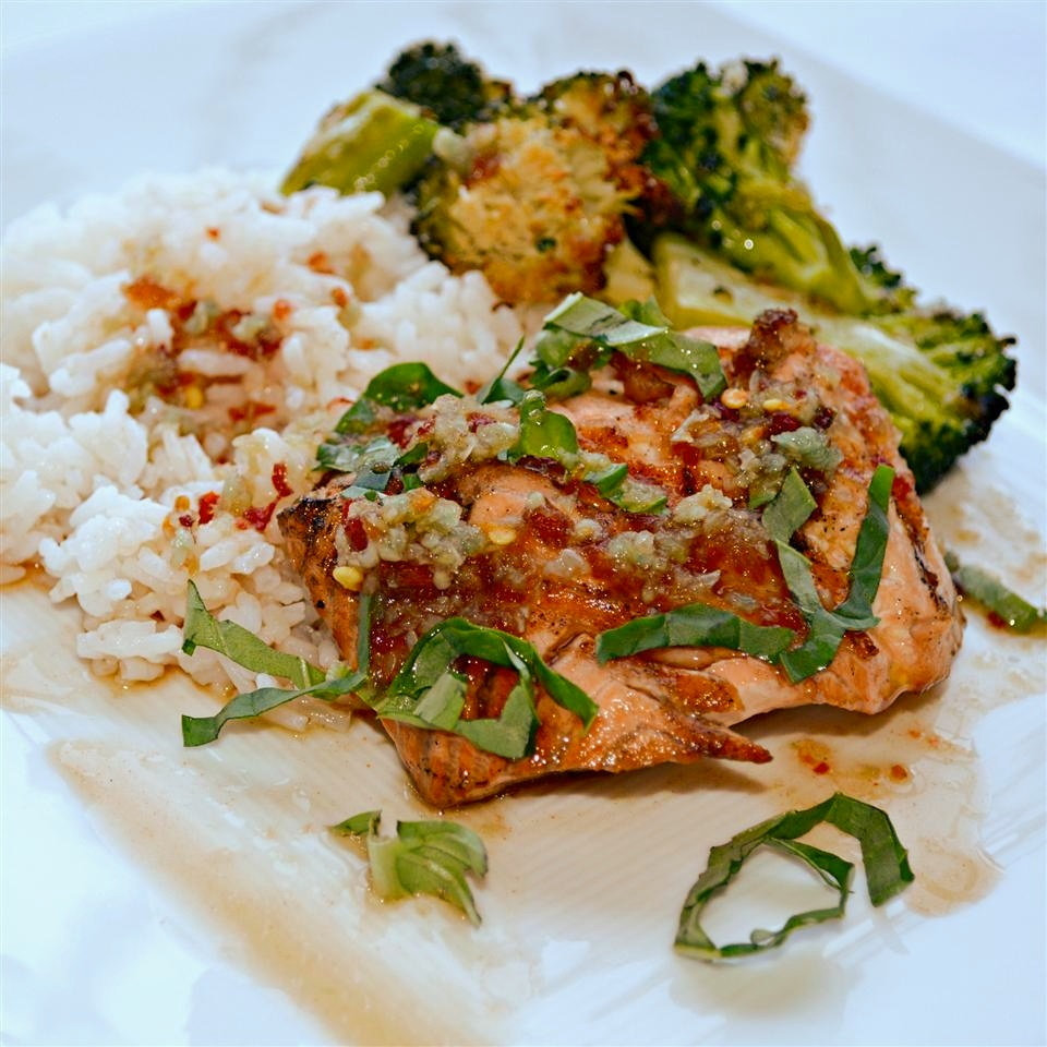 This glaze with chile paste, fresh ginger, soy sauce and fresh basil is delicious on salmon, but this recipe's submitter says it's also great on swordfish, halibut, tuna, or any other firm, full-flavored fish.