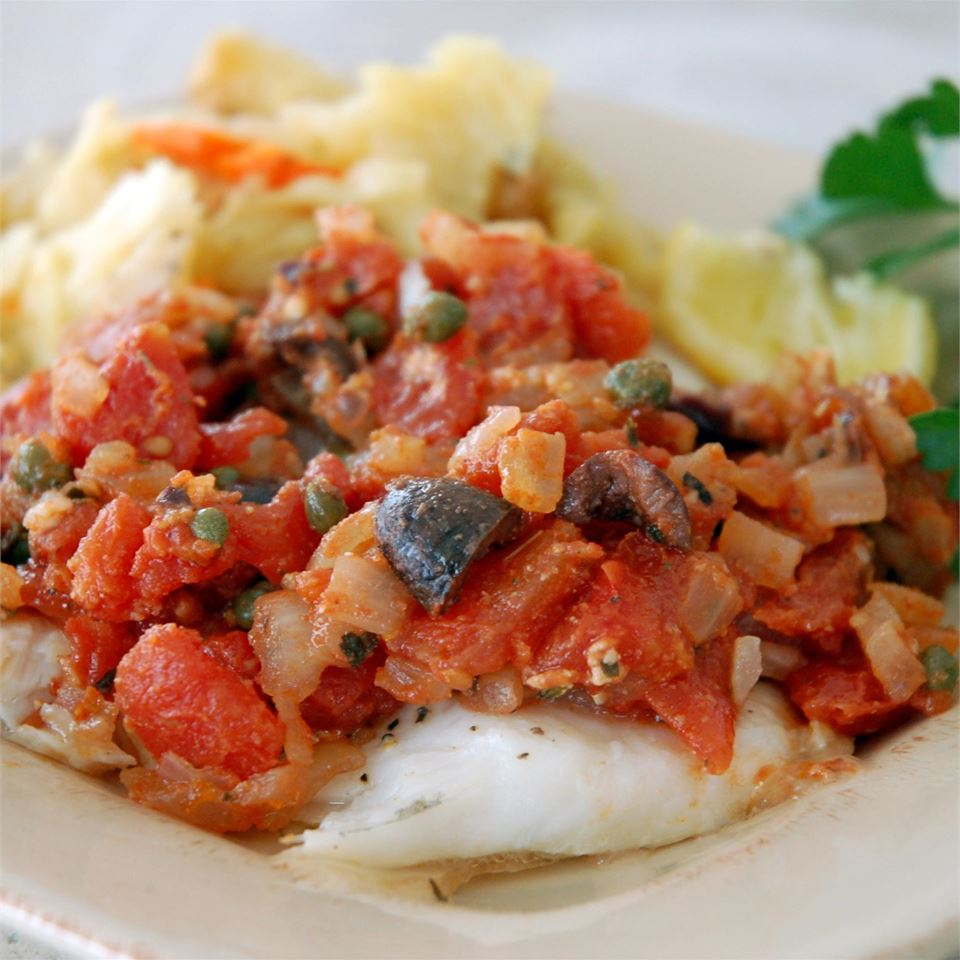flounder topped with tomatoes, capers, onions, garlic, and olives