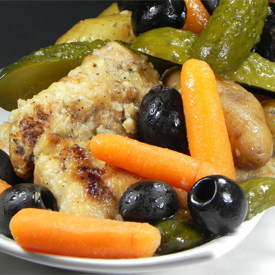 """""""If you love pickles you will love this,"""" says Kristie. """"Chicken thighs are browned and cooked with potatoes, carrots, pickles and black olives. Sounds scary I know but trust me it's good."""""""