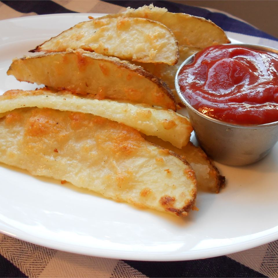Oven Fresh Seasoned Potato Wedges with ketchup on a white plate