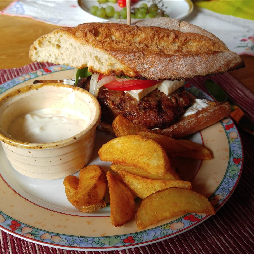 Mediterranean Lamb Burgers with potato wedges and a side of sauce