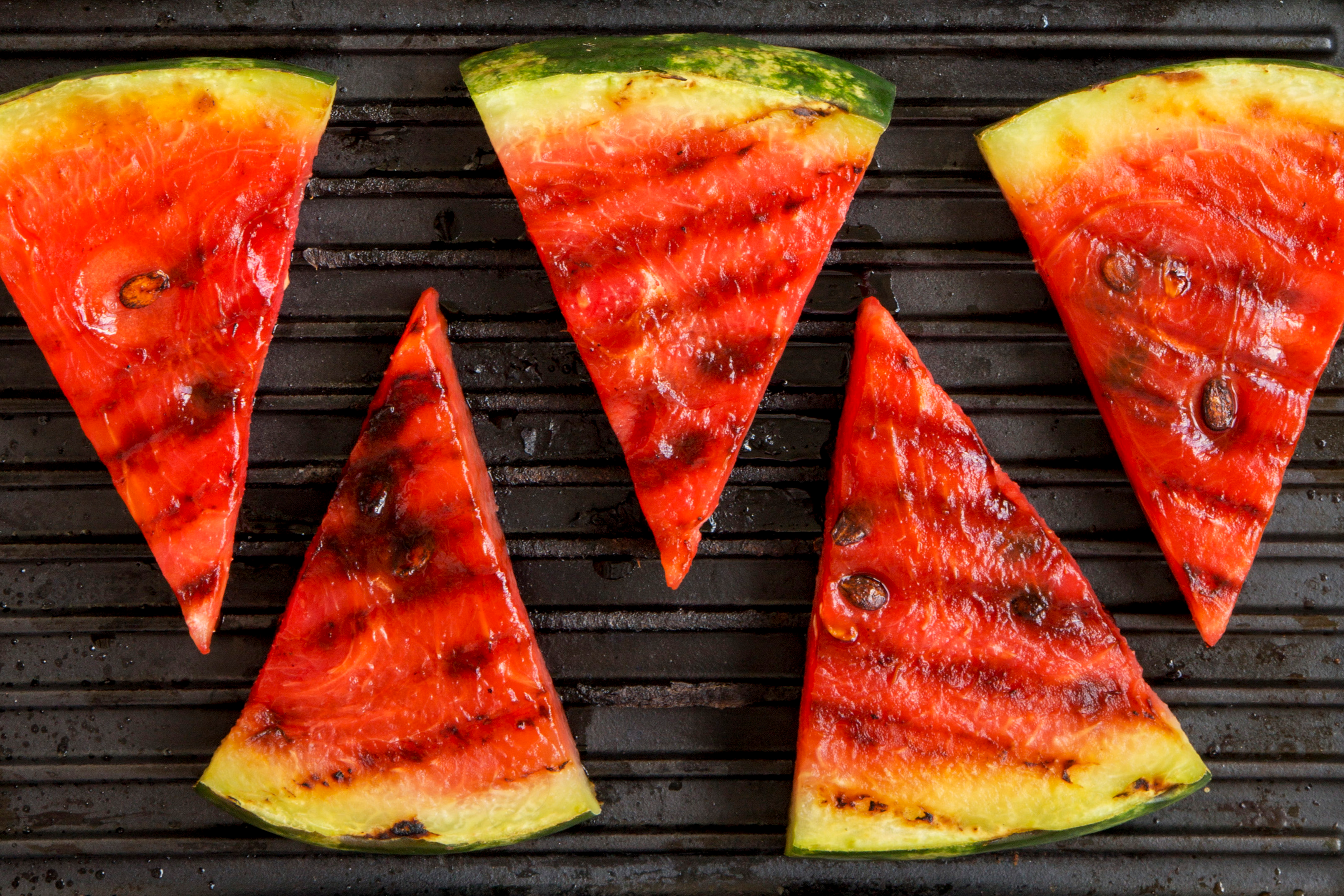 Slices of grilled watermelon in grilling pan, top view. Flat lay, overhead. Close-up.