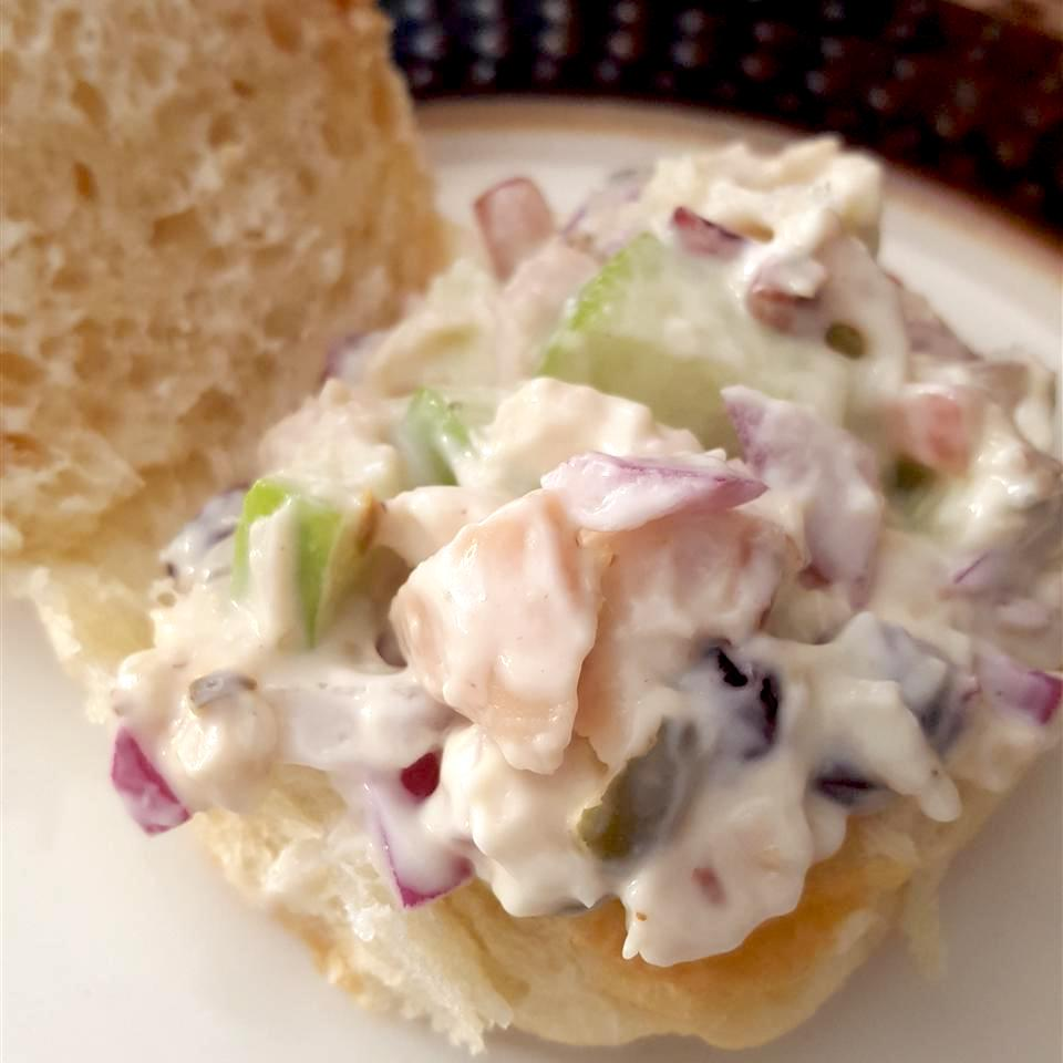 This chicken salad averages five stars. Reviewers suggest replacing vanilla yogurt with plain yogurt. Red grapes, chunks of Granny Smith apples, and dried cranberries provide sweetness.