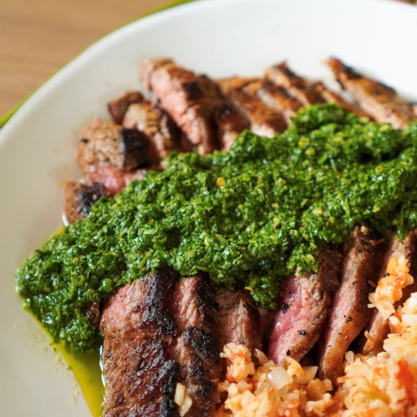 """This herby, garlicky, tangy, spicy, and very green condiment is great on all kinds of grilled meats,"" says Chef John. Incredibly versatile, Argentina's famous chimichurri sauce is typically paired with grilled meats. Try it over grilled steak, poultry, seafood, and veggies—and sop it up with grilled bread."
