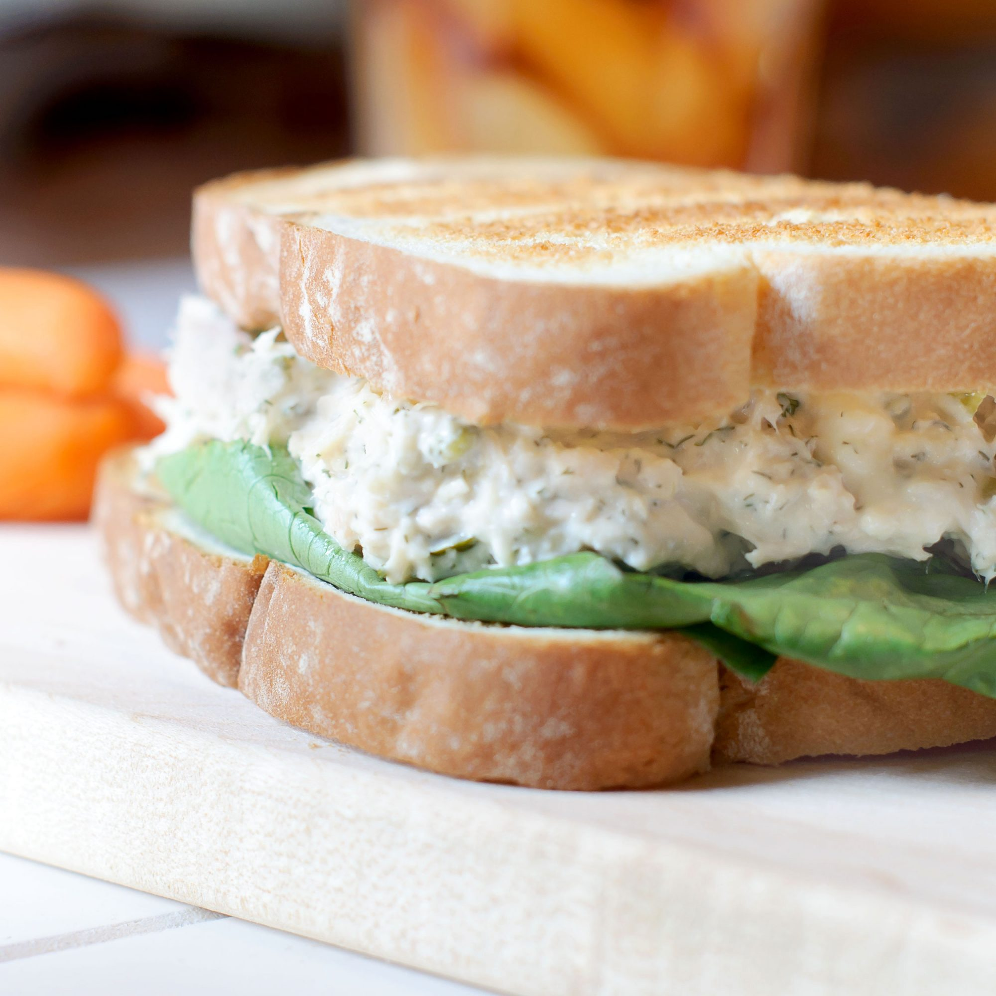 A tuna salad sandwich on toasted white bread