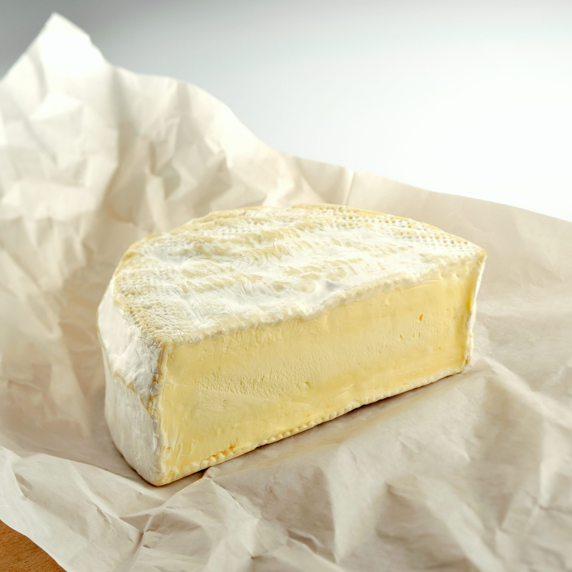 """""""Half wheel of Brillat-Savarin, a French brie made in Normandy. Shallow DOF but great texture on cheese."""""""