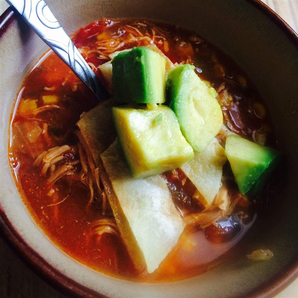 a bowl of Slow-Cooker Chicken Tortilla Soup with a spoon