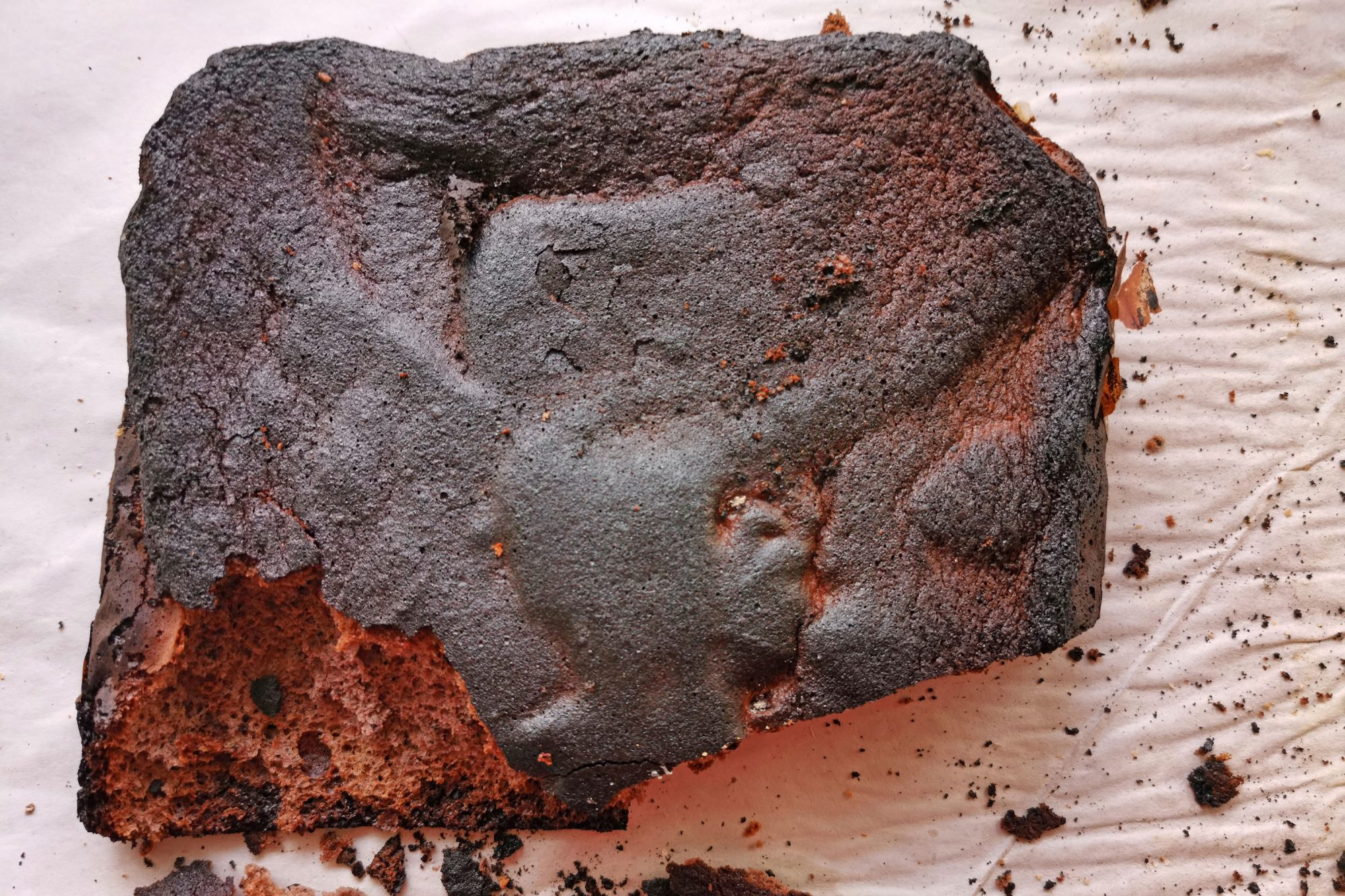 Burnt chocolate cake on parchment paper