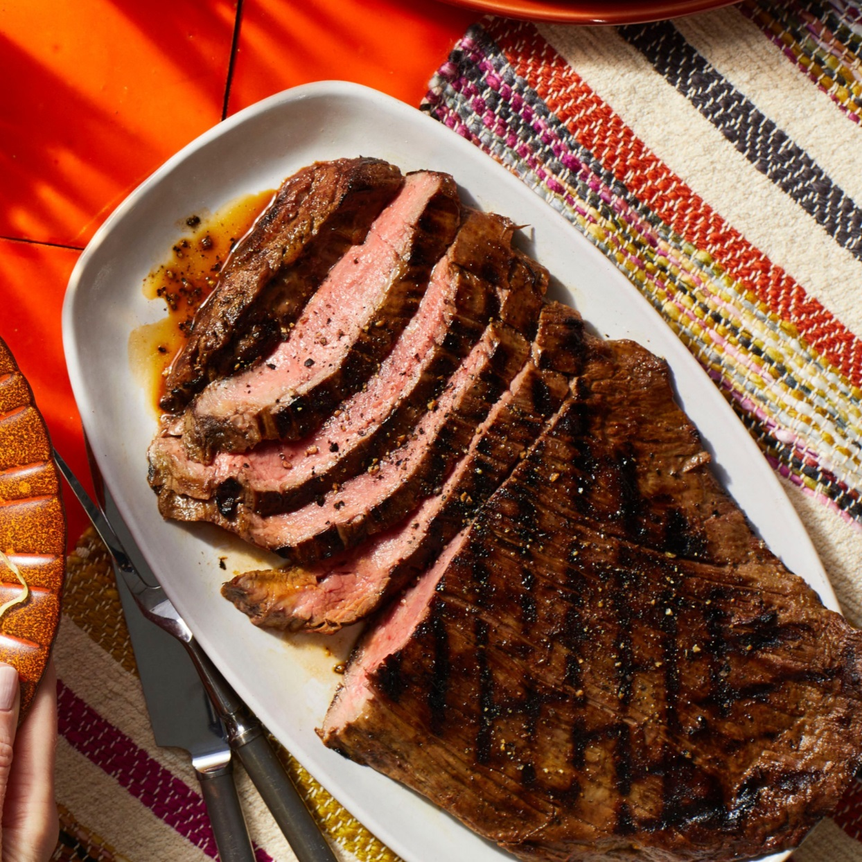 Flank steak with mojo marinade sliced on a platter