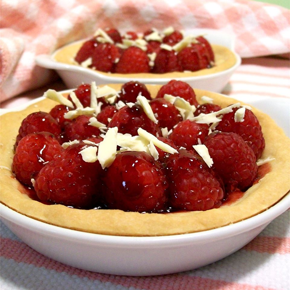 The only labor that goes into this easy dessert is making the crust, and that's hardly anything at all. The filling is just fresh raspberries and warm raspberry jam. You can make one big tart or a few small ones, as shown. Grate a little white chocolate over the top as a simple embellishment.