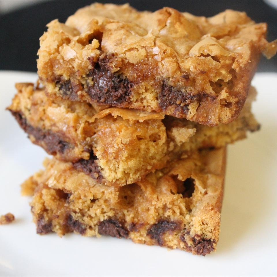 closeup of three blondies stacked on a white plate
