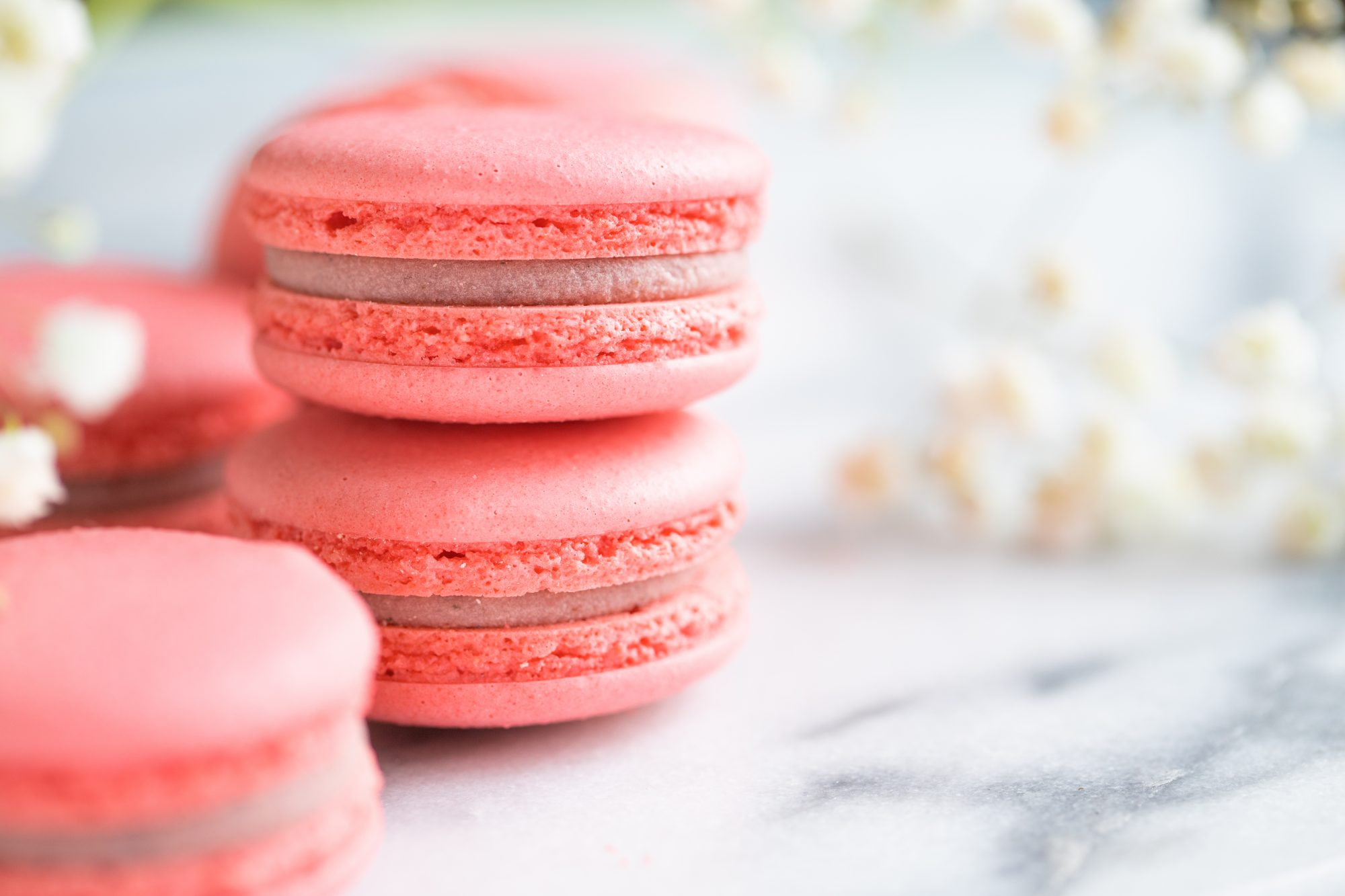 Coral Cakes Macarons Or Macaroons On White Marble Spring Background, Copy Space