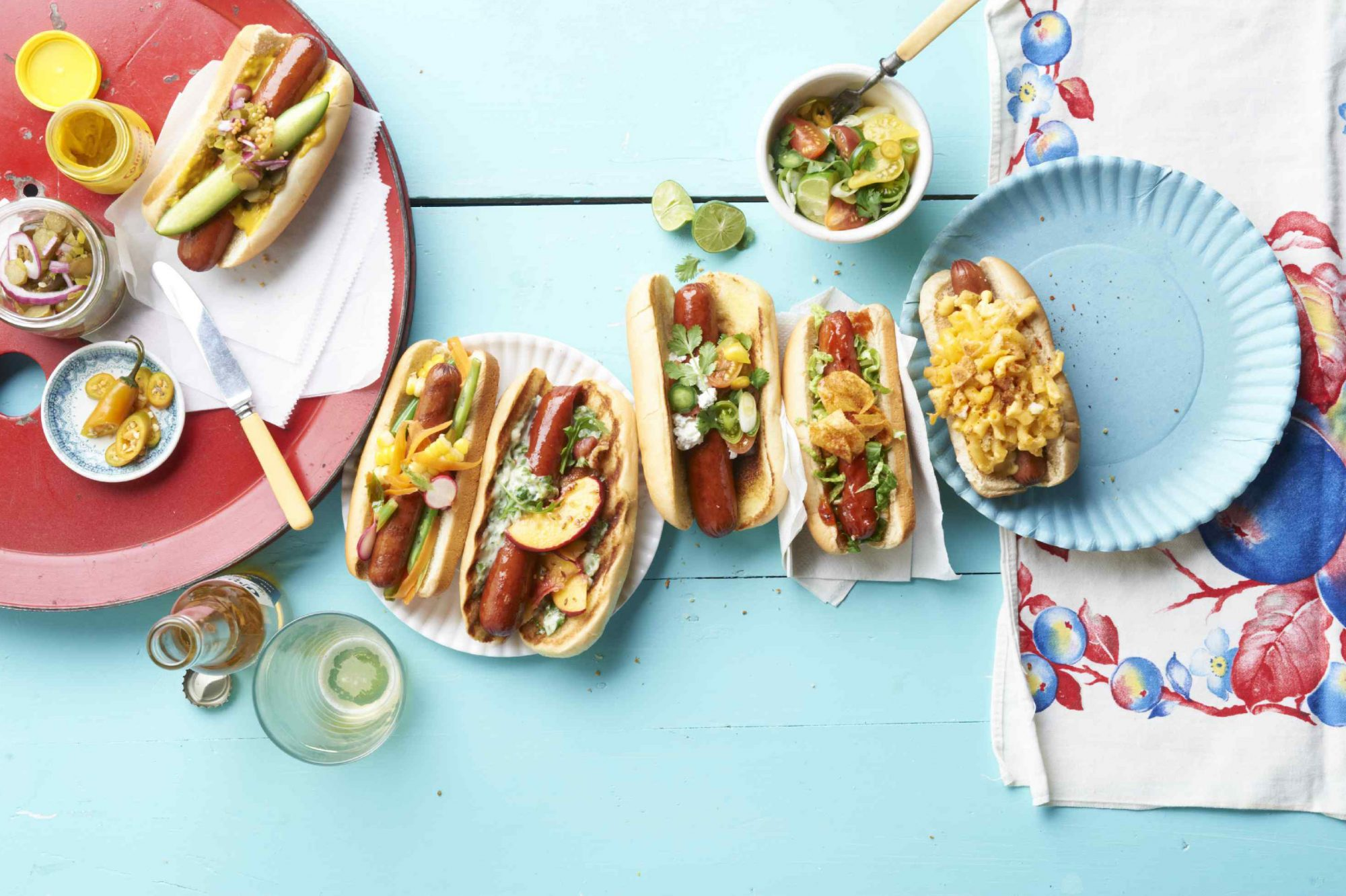 Hot dogs on light blue table