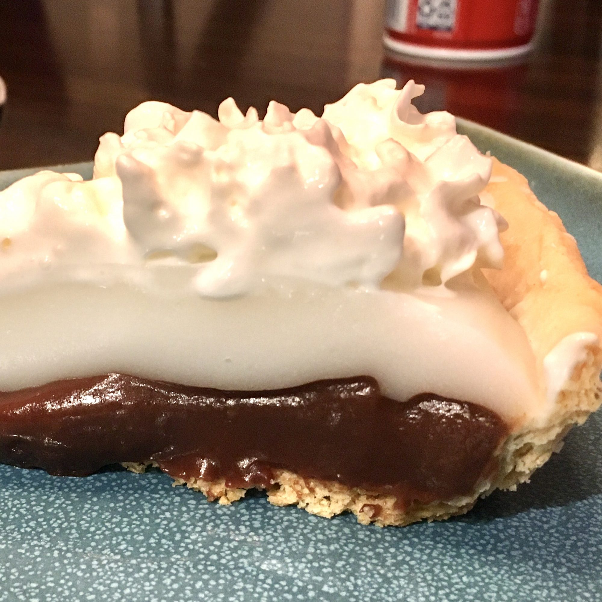 a slice of Coconut and Chocolate Pie on a blue plate