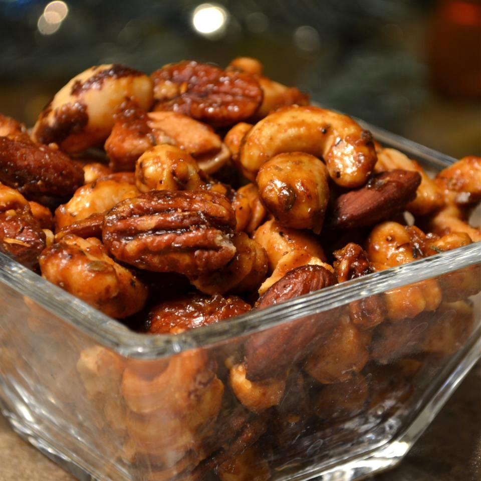 Sweet, Salty, Spicy Party Nuts in a glass dish