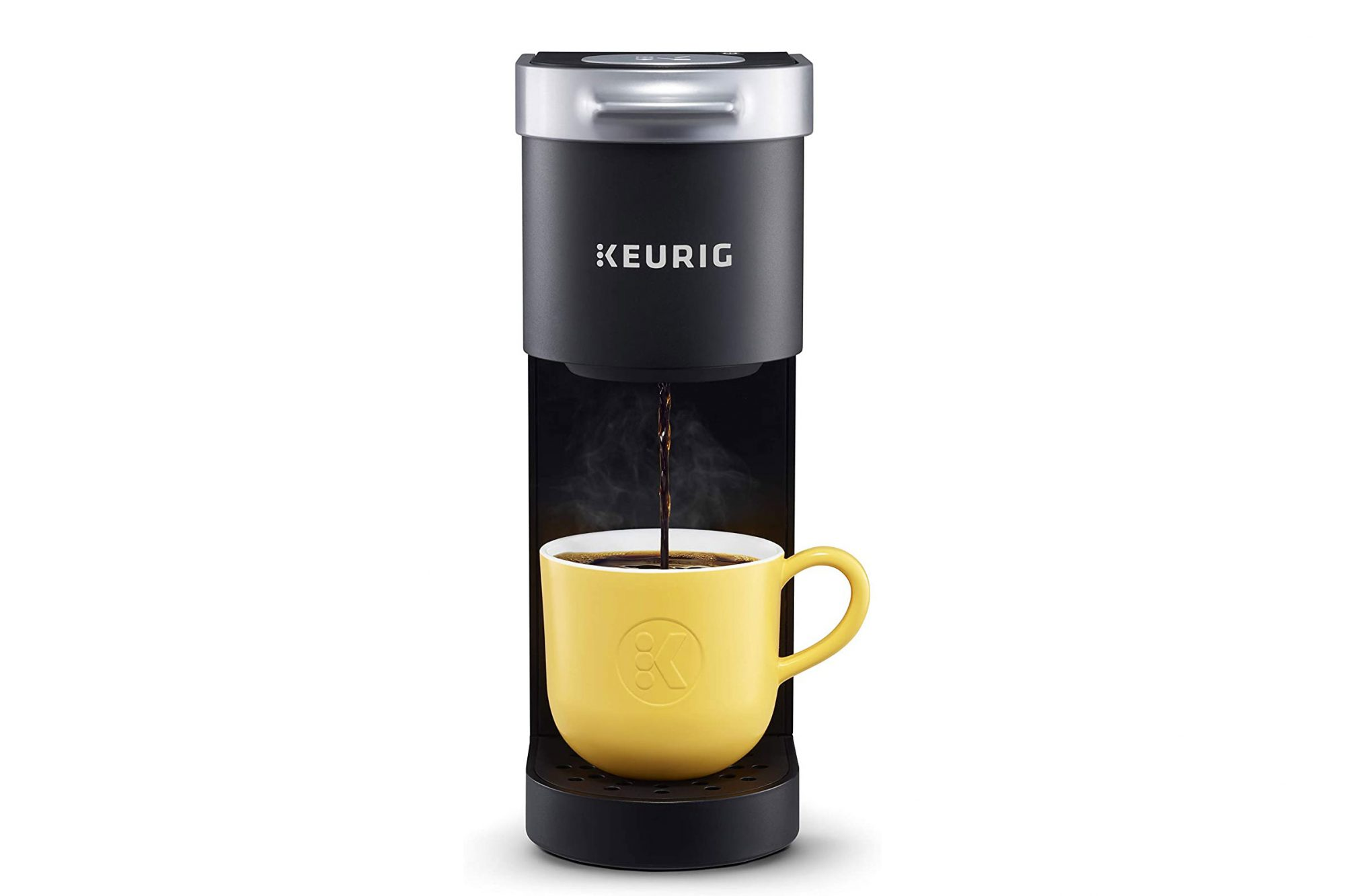 Keurig K-Mini pouring into yellow mug