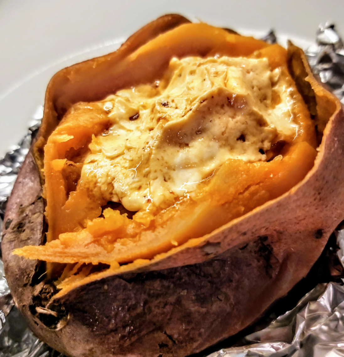 Baked Sweet Potatoes with Chipotle-Honey Butter