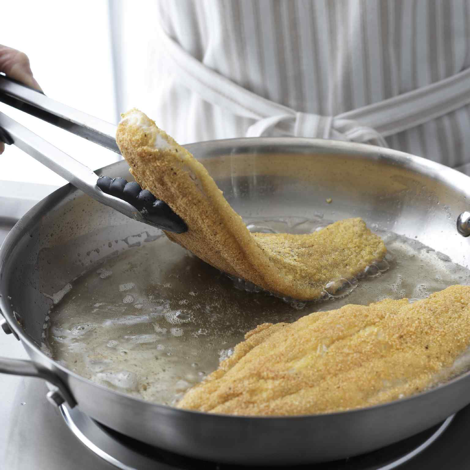 Fish fillets fried in pan