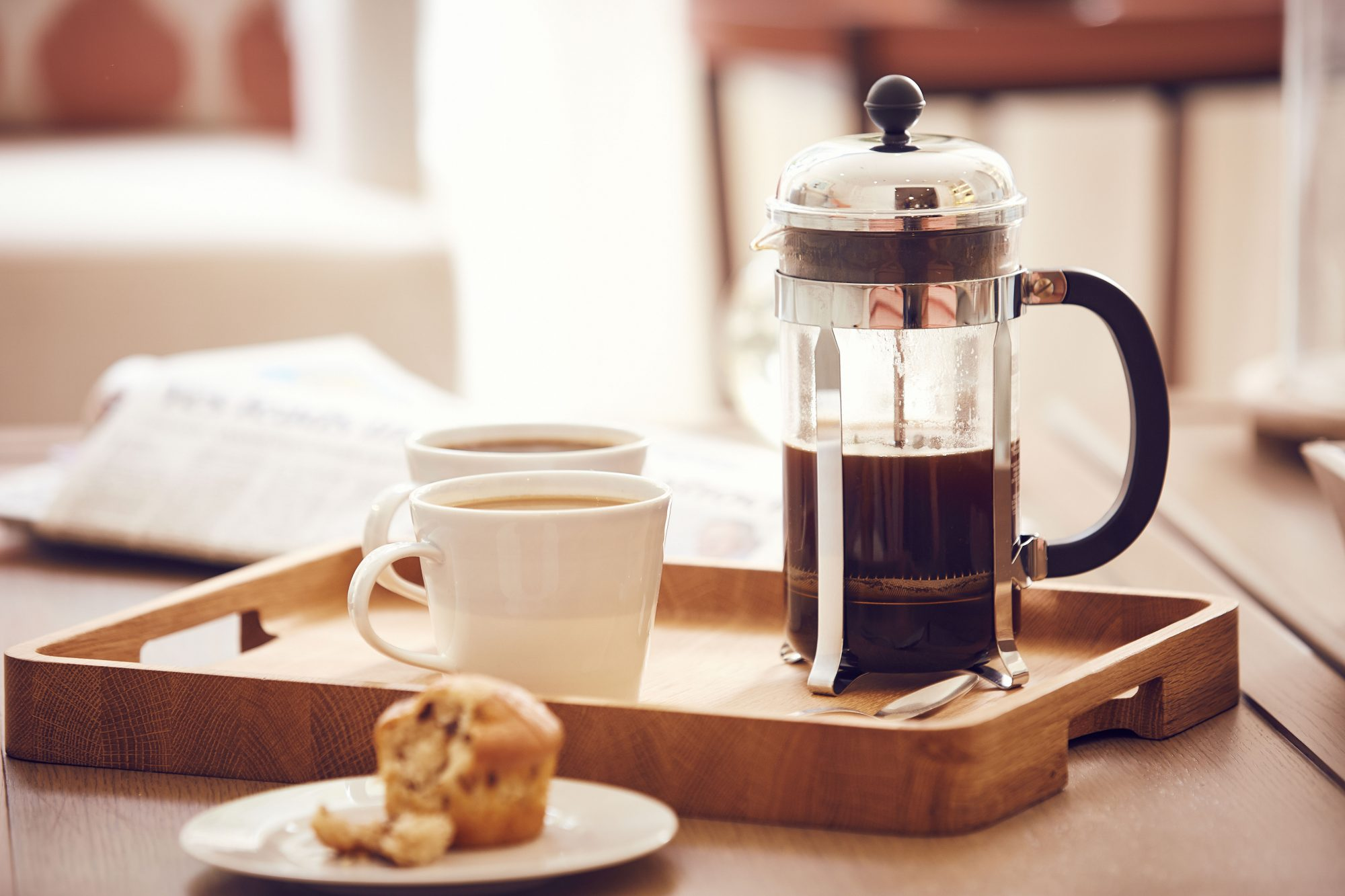 French Press Coffee Maker on breakfast tray with mugs of coffee