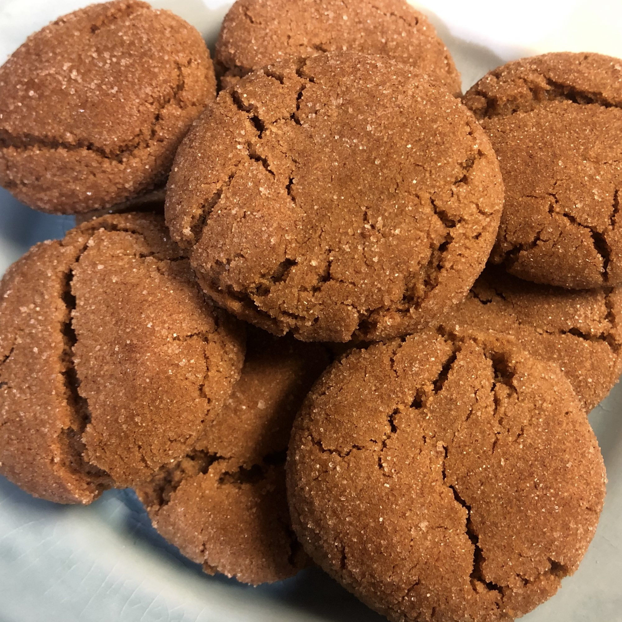 gingersnap cookies in a white dish