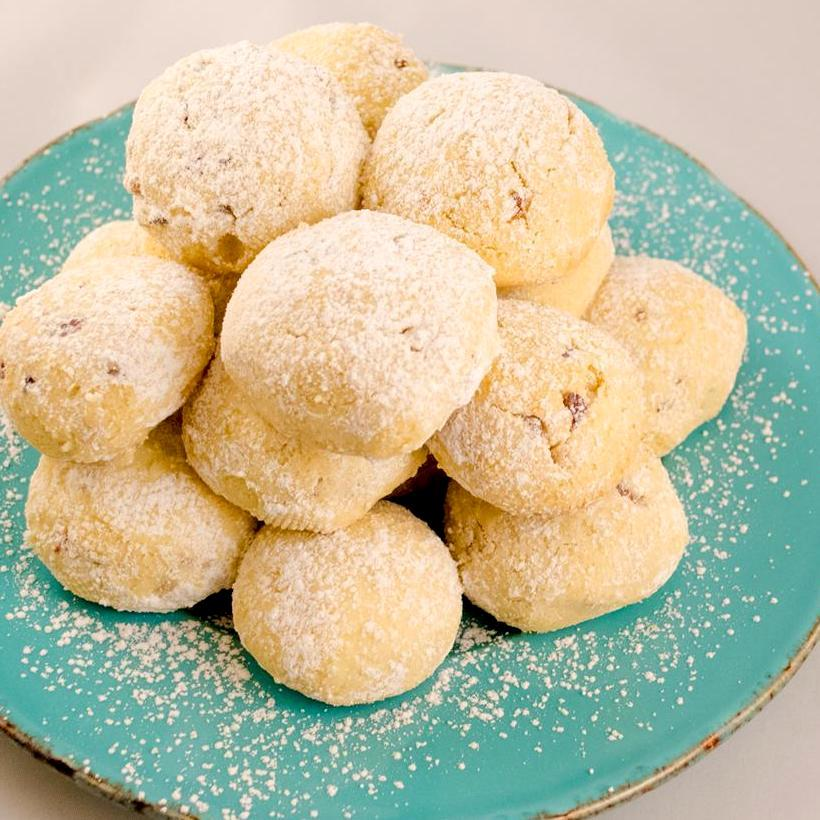 snowball cookies on a turquoise plate