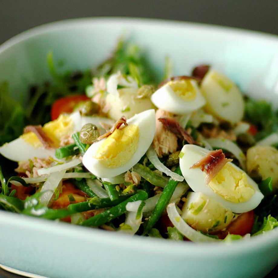 Nicoise salad in a white bowl