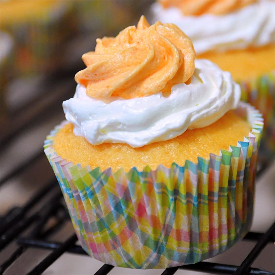 Dreamy Orange Cupcakes on a cooling rack