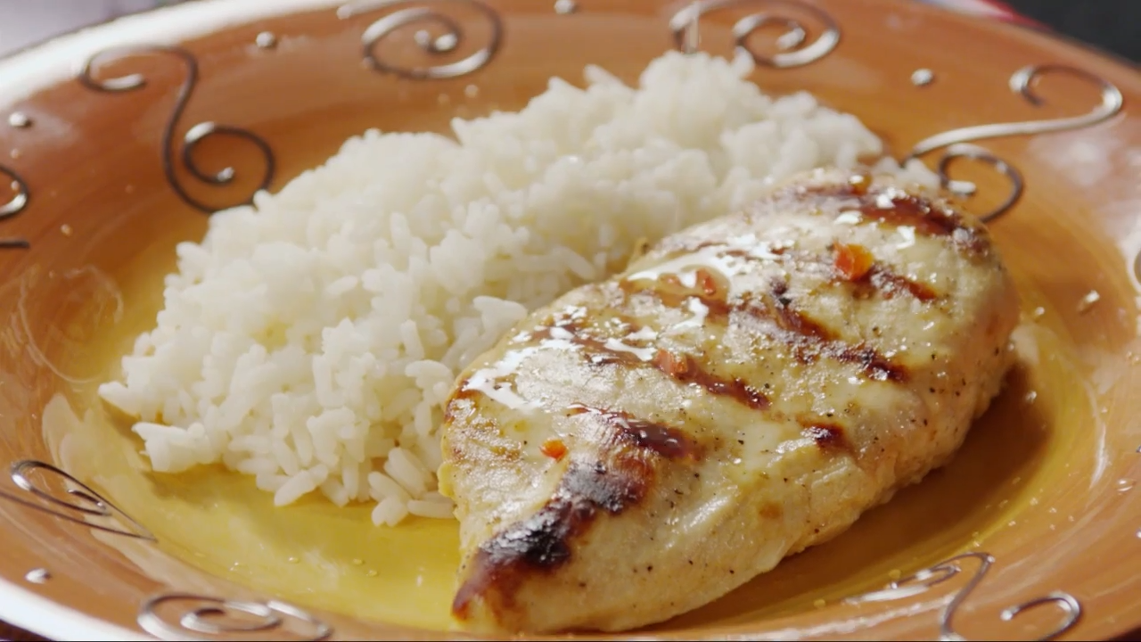 One grilled lemon chicken breast with white rice
