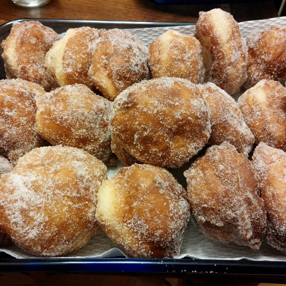 These Portuguese-style doughnuts are popular in areas settled by the Portuguese, specifically in Hawaii. They're leavened with yeast, giving them a light and fluffy texture. Once they have been fried, Malasadas are then rolled in sugar. They are often served plain, but they can be found filled with custard or fruit filling.                             Popular Malasadas Recipes:                                                          Malasadas                             Malasadas Dois