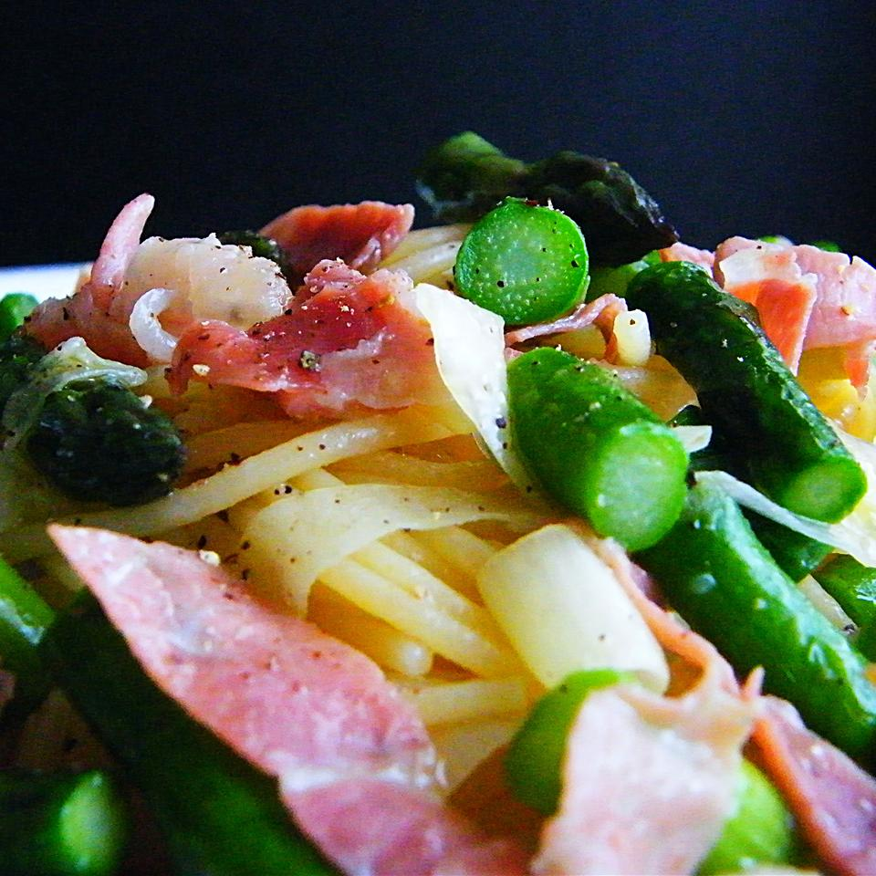 Prosciutto and Asparagus Pasta against a black background