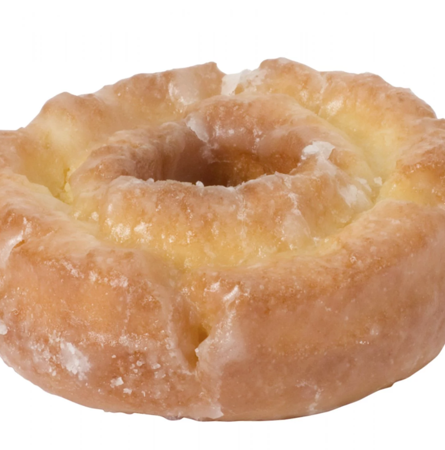 An old-fashioned doughnut, as the name suggests, dates all the way back to the 1830s. It has a similar glaze to the classic glazed doughnut, but with a more cakey base. It's a little rough around the edges, with a crunchy exterior but a soft inside. It has a larger hole in the center than most doughnuts, and it's peppered with cracks and ridges that soak up all the sweet glaze. You can also get them with chocolate glaze.