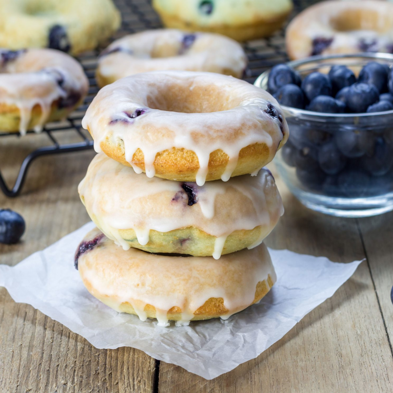 Blueberry doughnuts have an unassuming exterior, but they're one of the most beloved types. They are similar to old-fashioned doughnuts, with a hard exterior and a soft exterior. Blueberry doughnuts are glazed with a light, sugar glaze and packed with blueberry galore!