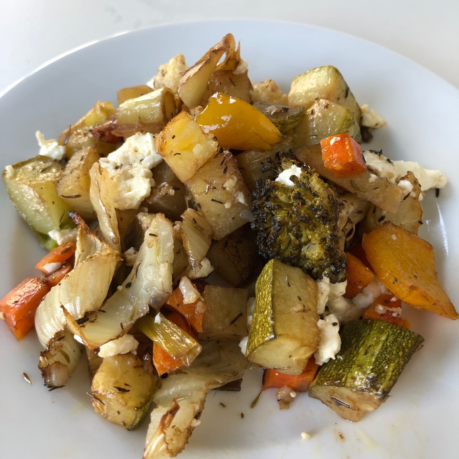 close up of roasted vegetables and feta